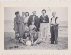 Family on beach in full clothes at Jaywick | Mrs Edna Randall