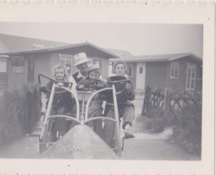 Family on 4 wheel social cycle called Playdiums | Mrs Edna Randall