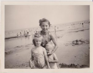 3 children on a beach in bathing costumes 1959 | Mrs Edna Randall