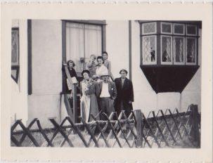 Family standing outside holiday chalet   Mrs Edna Randall