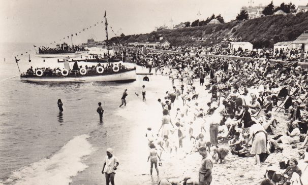 Nemo II & Viking Saga at Clacton beach, beach packed full of people sunbathing in deck chairs | Sourced by Roger Kennell, Clacton & District Local History Society