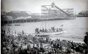 Nemo II passenger boat, Clacton pier in background with roller coaster, crowded beach | Sourced by Roger Kennell, Clacton & District Local History Society