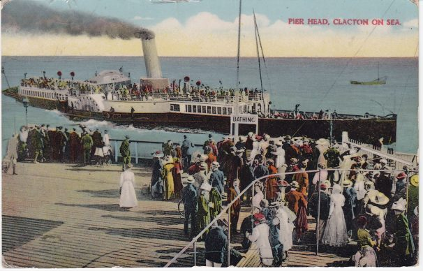 Colour-tinted postcard of Paddle Steamer arriving at Clacton Pier July 1914 with crowds watching | Sourced by Roger Kennell & Clacton & District Local History Society