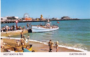 Passenger boat landing alongside groyne on Clacton beach, pier in background | Sourced by Roger Kennell, Clacton & District Local History Society