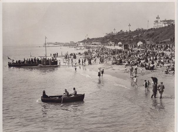 Public on beach, boats with people in water | Sourced by Roger Kennell, Clacton & District Local History Society