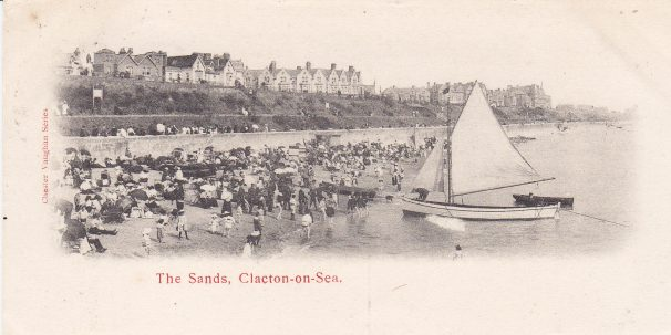 Small sailing boat moored at waterline of East Beach, Clacton, crowds around it | Sourced by Roger Kennell, Clacton & District Local History Society