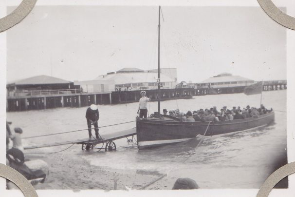 Motor boat pre-war with passengers, location not listed, landing platform wheeled in beside boat | Sourced by Roger Kennell, Clacton & District Local History Society