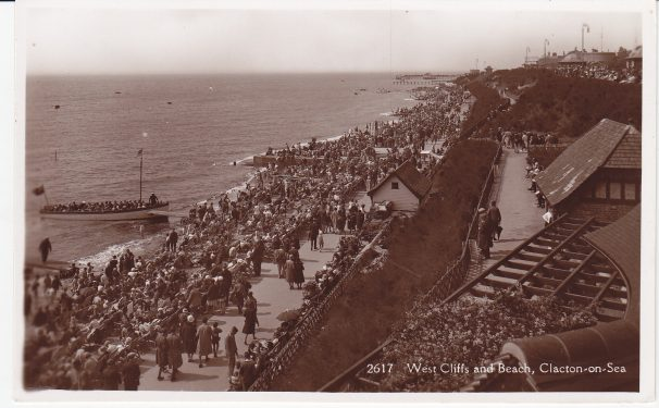 Beach packed full of people at leisure on beach. Boat mooring up with passengers | Sourced by Roger Kennell, Clacton & District Local History Society