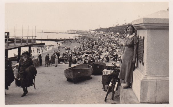 Lady leaning against column entrance to Clacton beach | Sourced by Roger Kennell, Clacton & District Local History Society