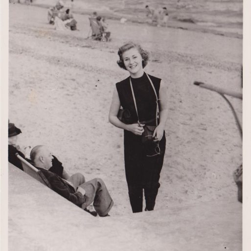 Young woman in 20s on beach with capri trousers and tank top | Photo by Clacton Press Agency
