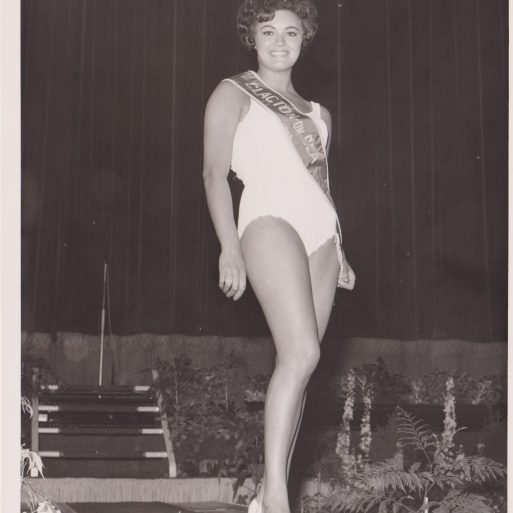 20 something young woman posing in bathing suit on stage with Miss Clacton-on-Sea sash | Photo donated by Tendring DC, unaccredited photographer
